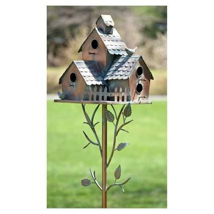 Metal birdhouse on a stake