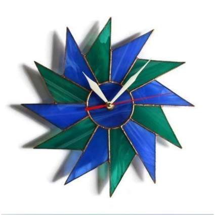 blue and green stained glass starburst clock