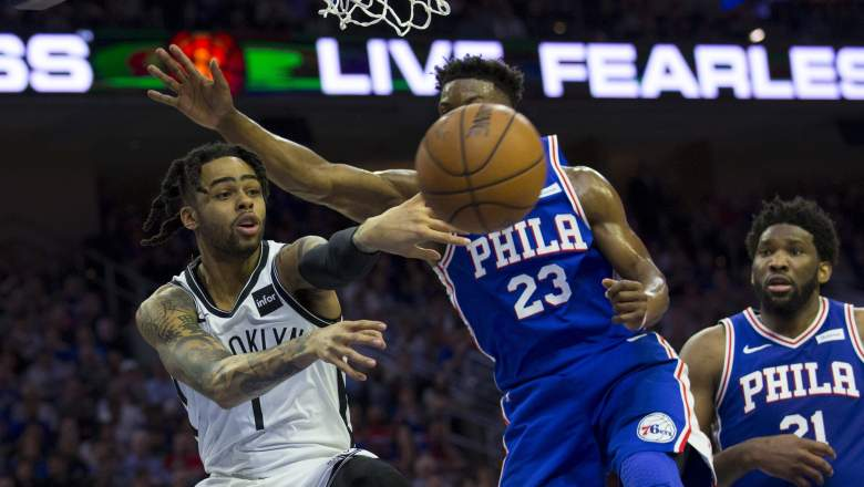 D'Angelo Russell #1 of the Brooklyn Nets passes the ball against Jimmy Butler #23 of the Philadelphia 76ers