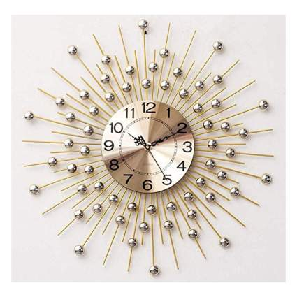 gold and silver metal starburst clock