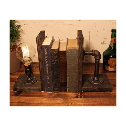 pipe lamp bookends on wood base
