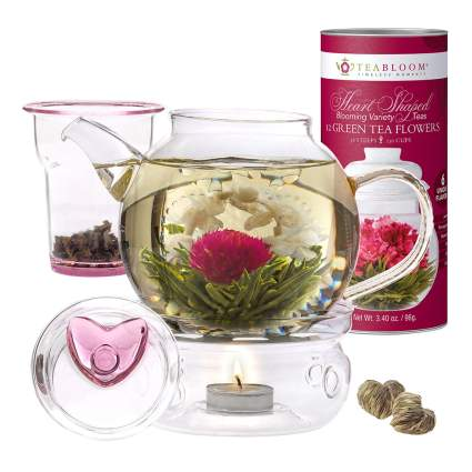 Glass teapot with blooming flower tea