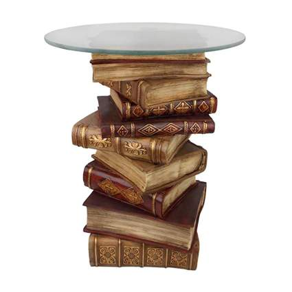 vintage stacked books glass top end table