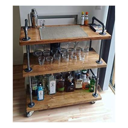 wood and metal pipe bar cart