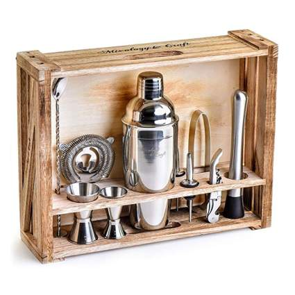 stainless steel cocktail shaker set in wood stand