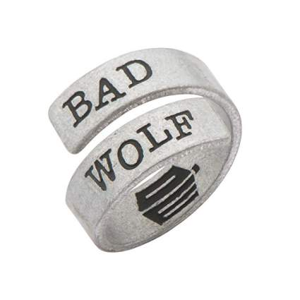 """Silver wrap ring that says """"Bad Wolf"""""""