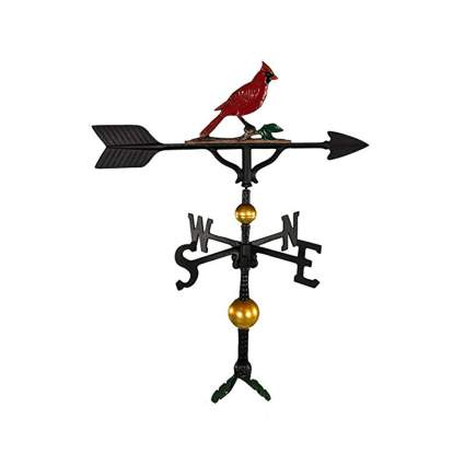 black and gold weathervane with red cardinal
