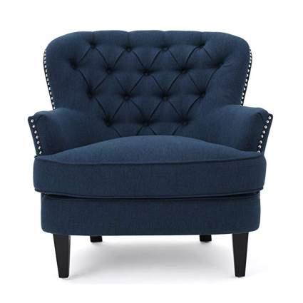 dark blue tufted arm chair
