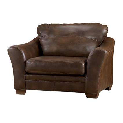brown faux leather chair and a half