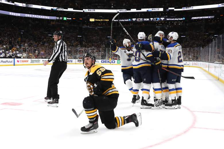 David Perron #57 of the St. Louis Blues scores a third period goal following a controversial no-call.