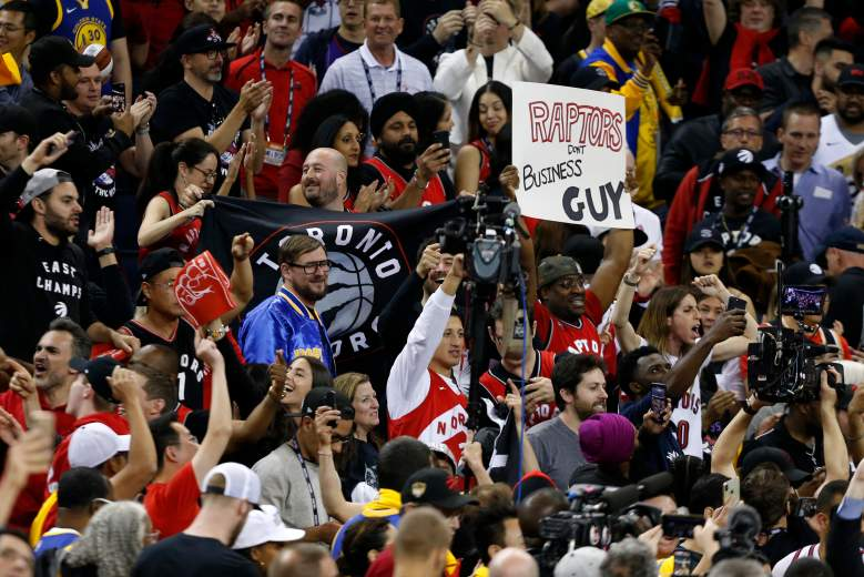 Toronto Raptors fans celebrate following their team's Game 4 win over the Golden State Warriors at Oracle Arena.