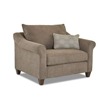 tan overstuffed chair with throw pillow