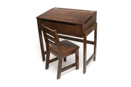 Dark traditional school desk with chair