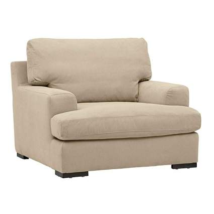 cream overstuffed reading chair