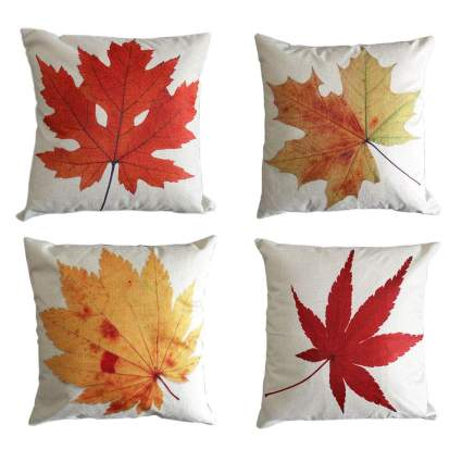 Cream pillows with red leaves