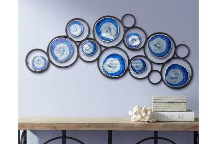 Circular metal and blue wall art
