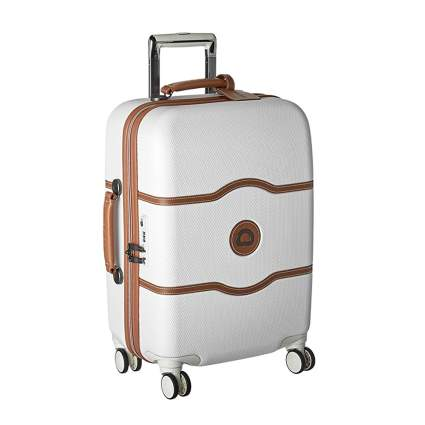 tan abd cream hardside carry on bag