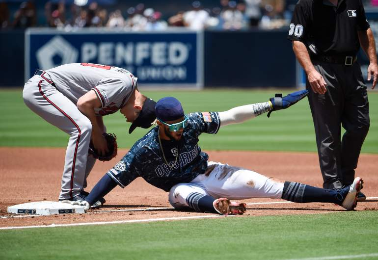 You've got to see this move San Diego Padres shortstop Fernando Tatis Jr. makes to safely get back to first base during a rundown on Sunday.