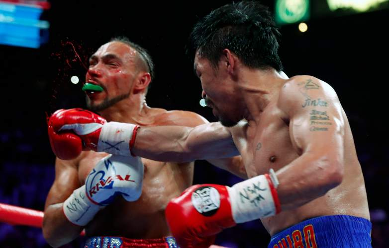 Manny Pacquiao delivered a few punishing blows to Keith Thurman during their Welterweight title fight on Saturday, but Thurman persisted for a 12-round classic.