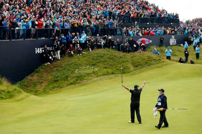 Republic of Ireland's Shane Lowry fought through inclement weather on his way to winning his first major, capturing The Open Championship on Sunday.
