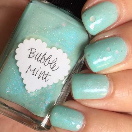 sea green nail polish with bottle