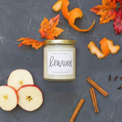 White jar candle with fall spices