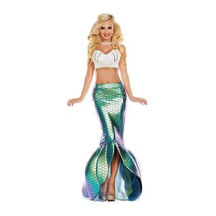 Woman in metallic green mermaid skirt