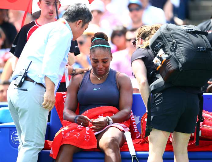 Serena Williams broke down in tears as she was forced to retire from the Rogers Cup final on Sunday due to back spasms.
