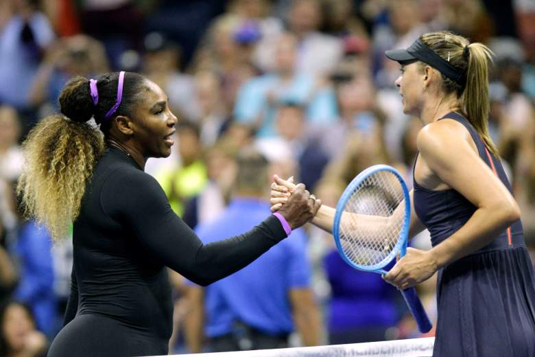 Serena Williams and Maria Sharapova meet at the net following their opening round match at the U.S. Open.