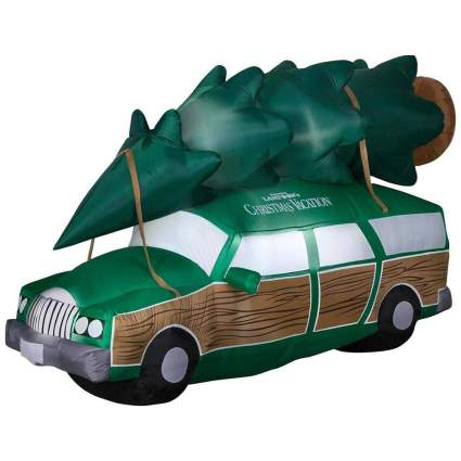 Griswald station wagon with pine tree strapped on top inflating decoration