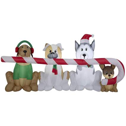 Dogs and a large candy cane blow up decoration