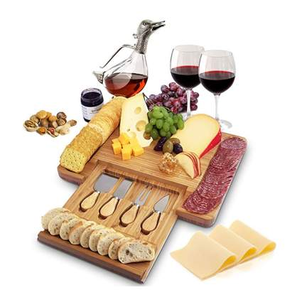 bamboo cheese board with serving tools