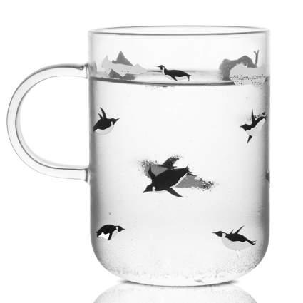 Glass mug with swimming penguins