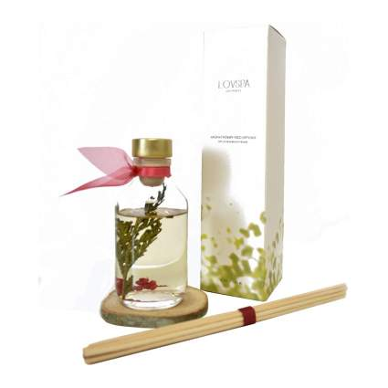 Glass scent diffuser with white box and pink ribbon