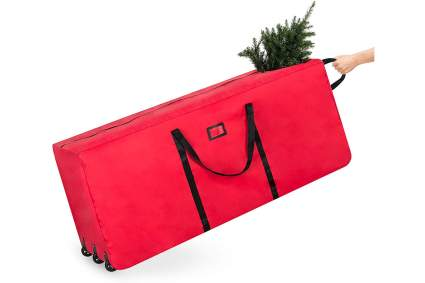 Red holiday tree bag on wheels