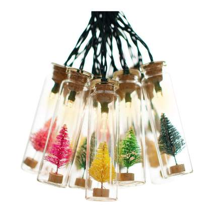 Bottle lights filled with mini coloful christmas trees