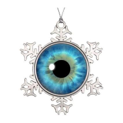 Snowflake with realistic blue eyeball