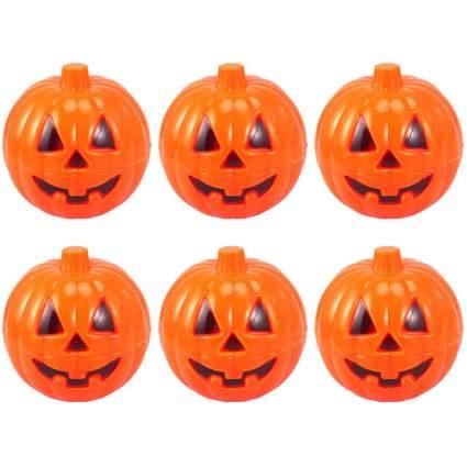 Six tiny plastic jack o' lanterns