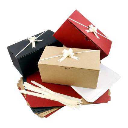 colored gift boxes with tissue and bows