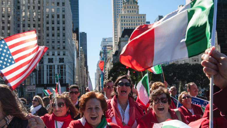 Attendees wave flags at the NYC Columbus Day Parade