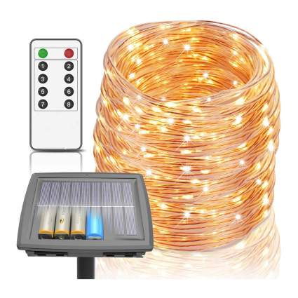 Coil of yellow string lights with solar panel