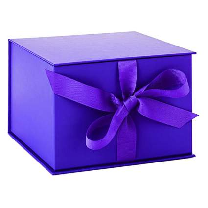 large purple gift box with ribbon closure