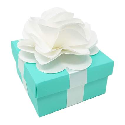 Mint green gift box with paper flower