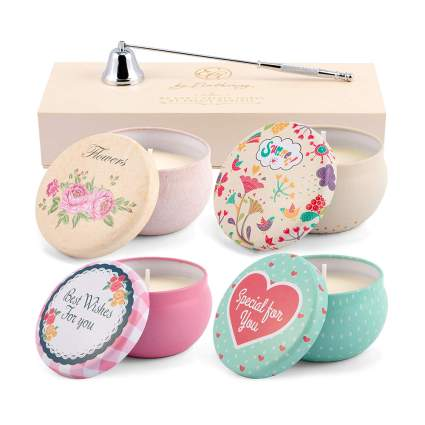 scented candles in tins with snuffer