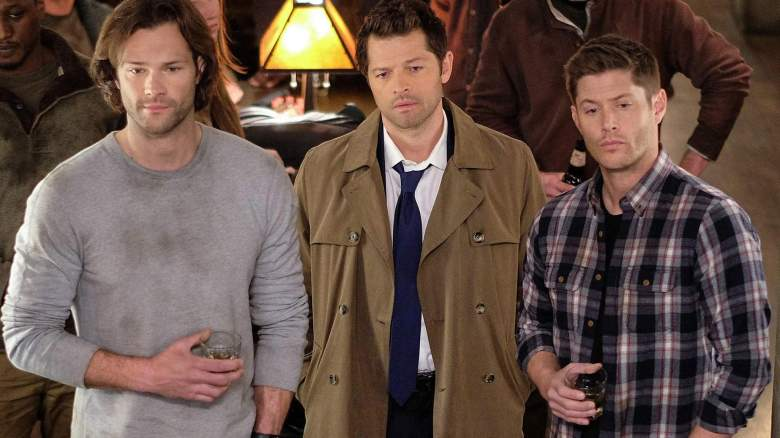 Sam, Dean, and Castiel look on in a still from Supernatural