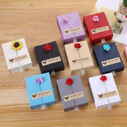 Small colorful boxes with fake flowers