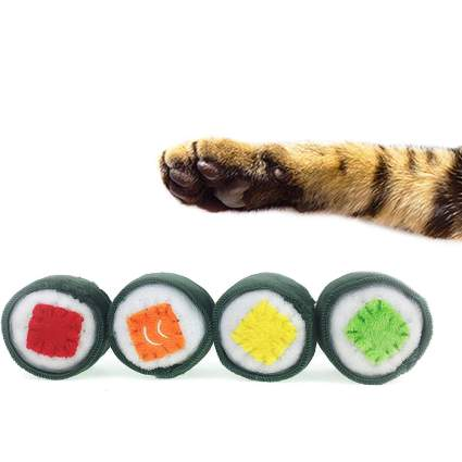 Cat paw with fake sushi rolls