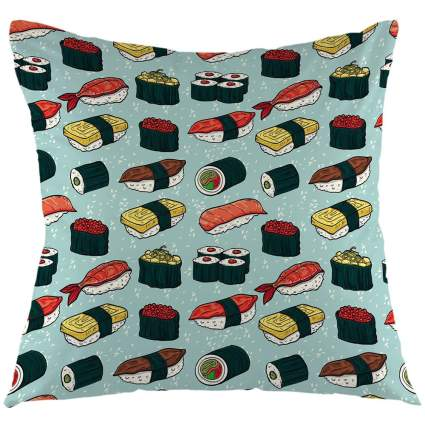 Green pillow with sushi pattern