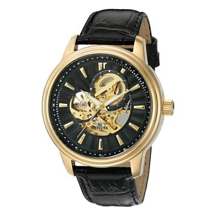 black and gold exposed gears men's watch