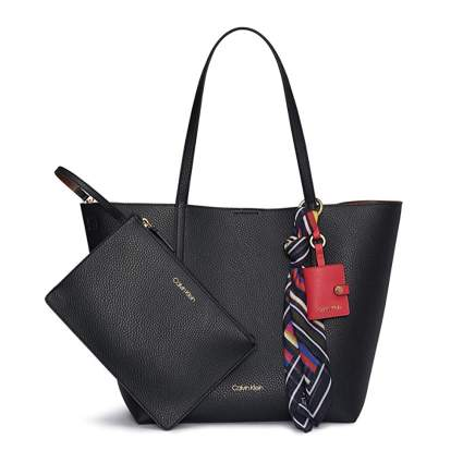 black tote bag and clutch
